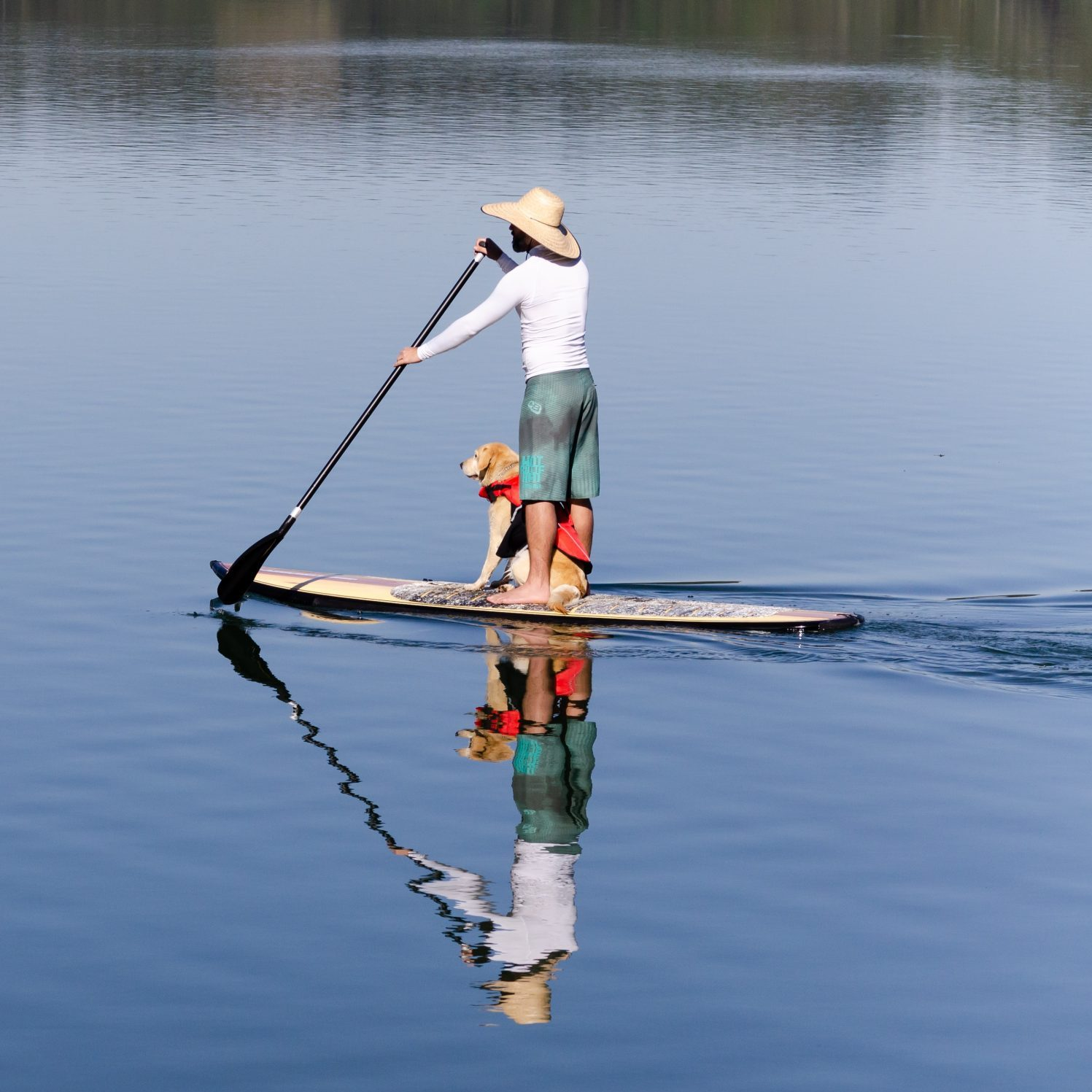 man standing on boat holding boat paddle